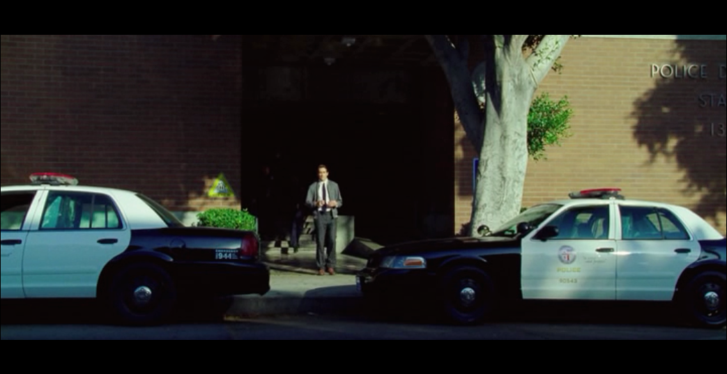 Screenshot from  Nightcrawler  of Lou Bloom as he exits the police station - filmed at the real-life LAPD Hollywood Station.
