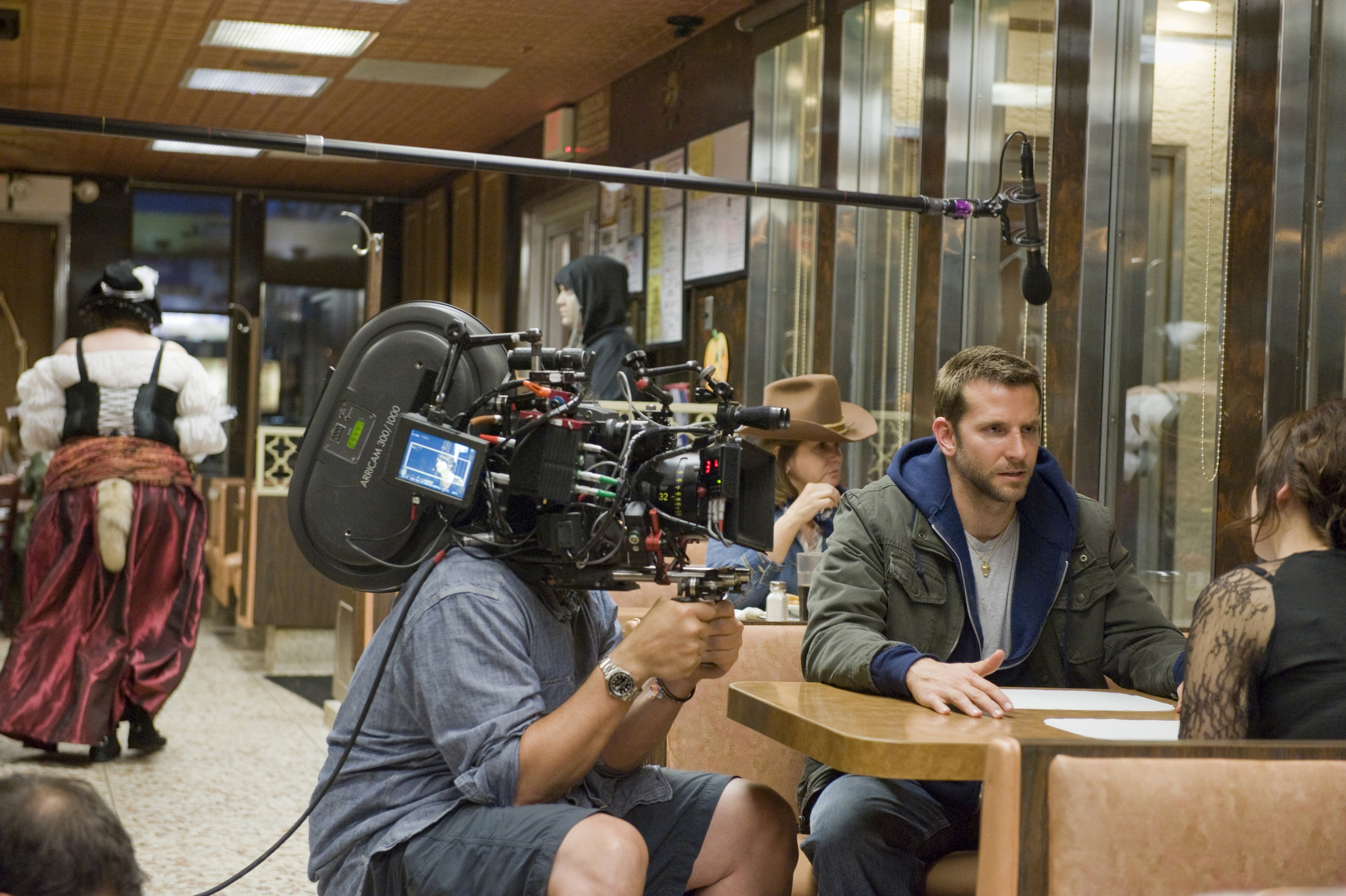 A behind-the-scene look on the set of  Silver Lining Playbook , also filmed in Philadelphia (at theLlanerch Diner in this scene), featuring Bradley Cooper and Jennifer Lawrence - image via  Google .