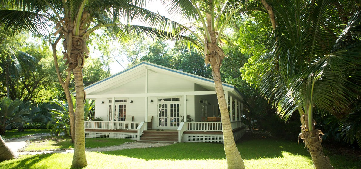 A charming cottage at the Moorings Village & Spa - image via the  resort's website .