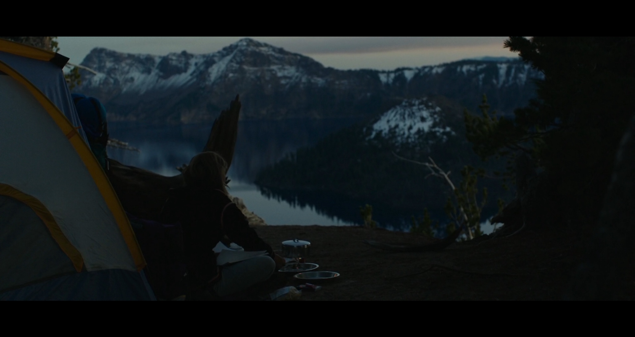 Screenshot of a scene filmed at Crater Lake as Cheryl (Reese Witherspoon) camps for the night at the deep blue lake.