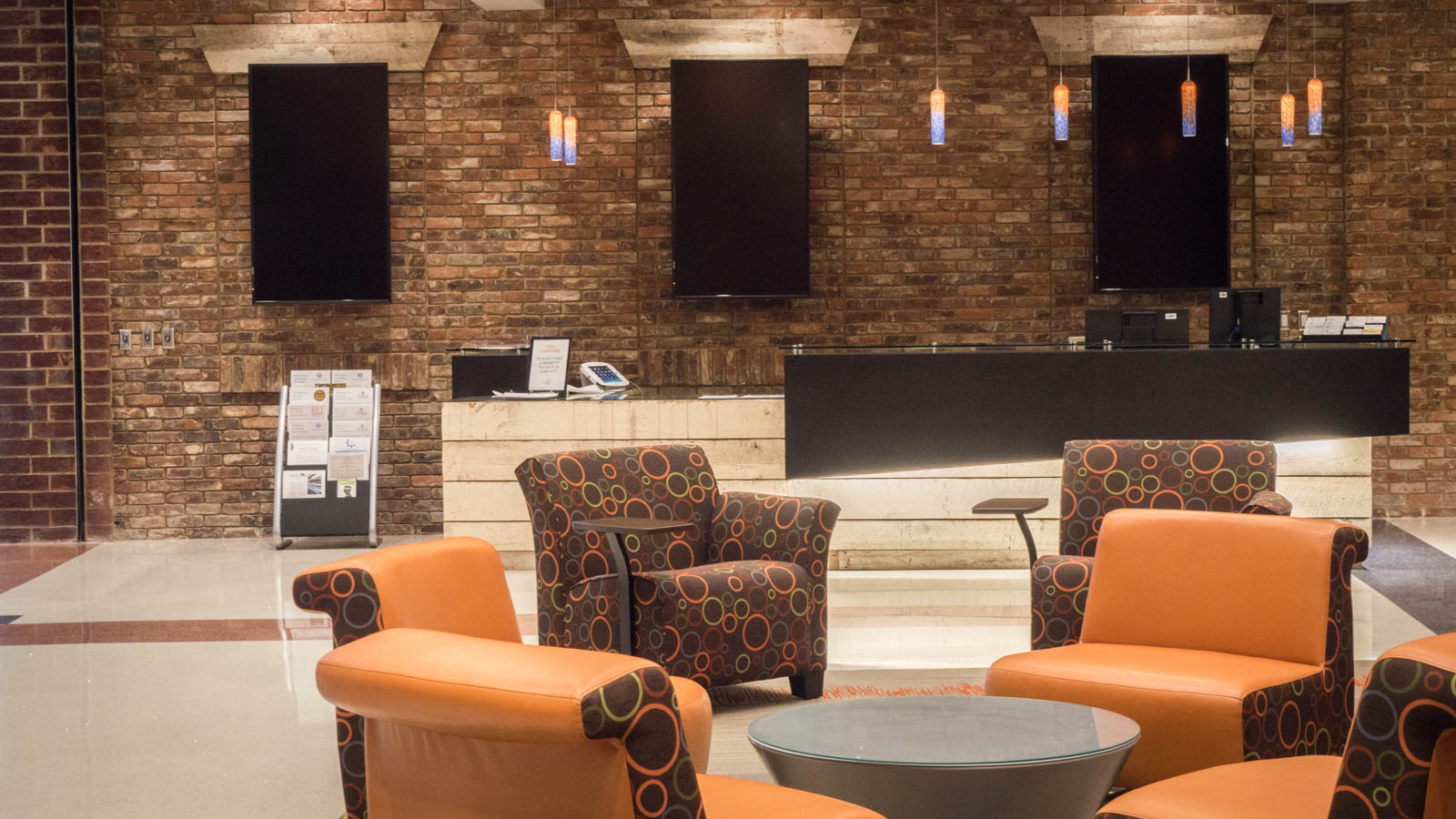 The reception desk in the main lobby is made from reclaimed wood and brick from the former Bassett Furniture Superior Lines factory.