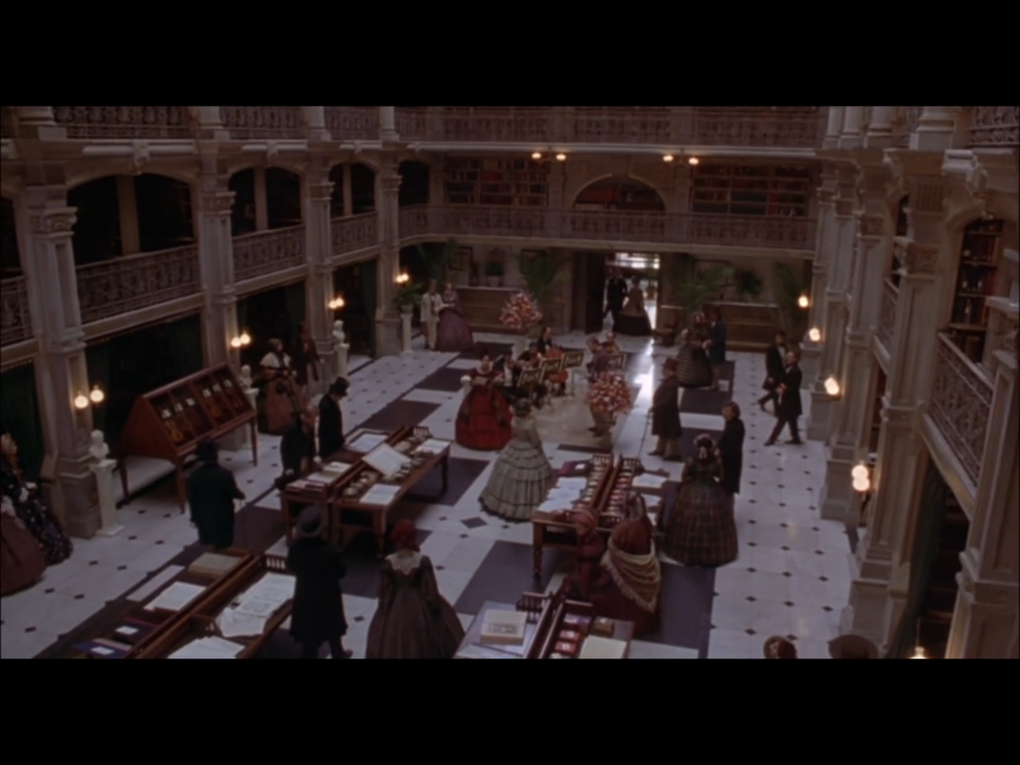 Screenshot from Washington Square of a Paris bookshop scene filmed on location at the main reading room of the George Peabody Library.
