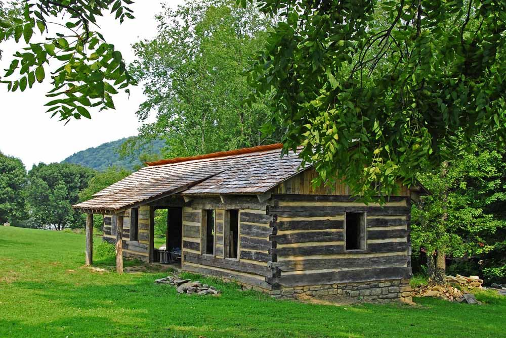 A cabin in Prickett's Fort State Park - photo via  LocationsHub .