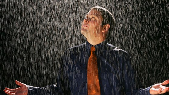 man standing in rain.jpg