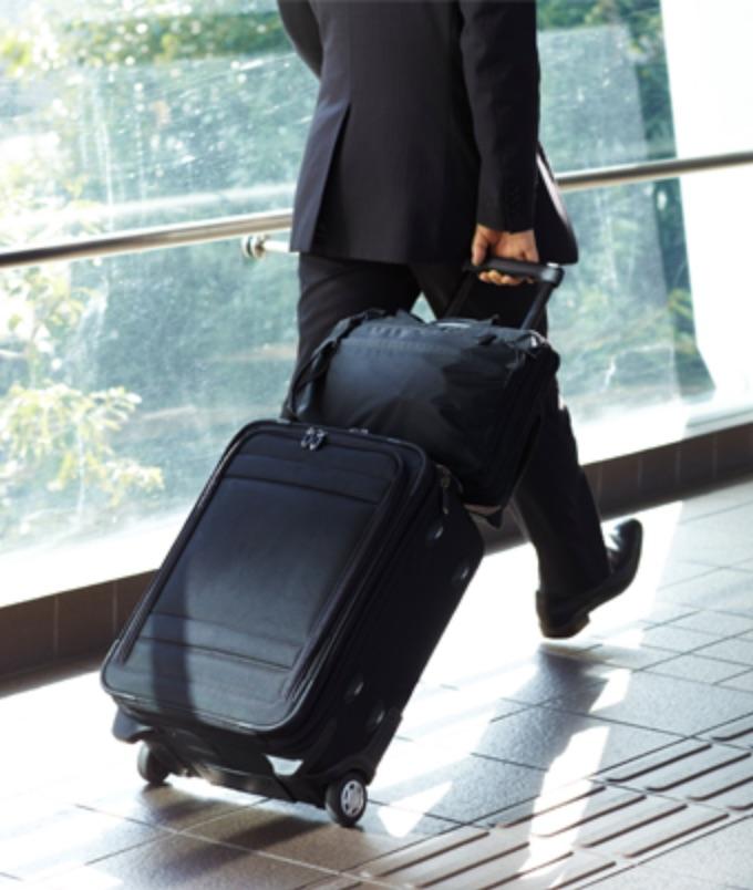 man in suit rollaboard luggage.jpg