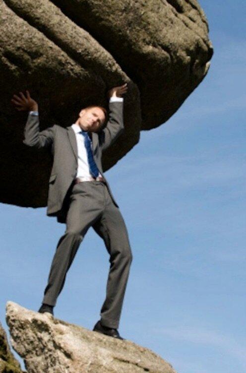 man holding up huge rock.jpg