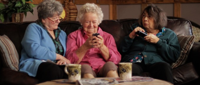 Three elderly women living in a retirement home fumble with modern technology while trying to land a date.