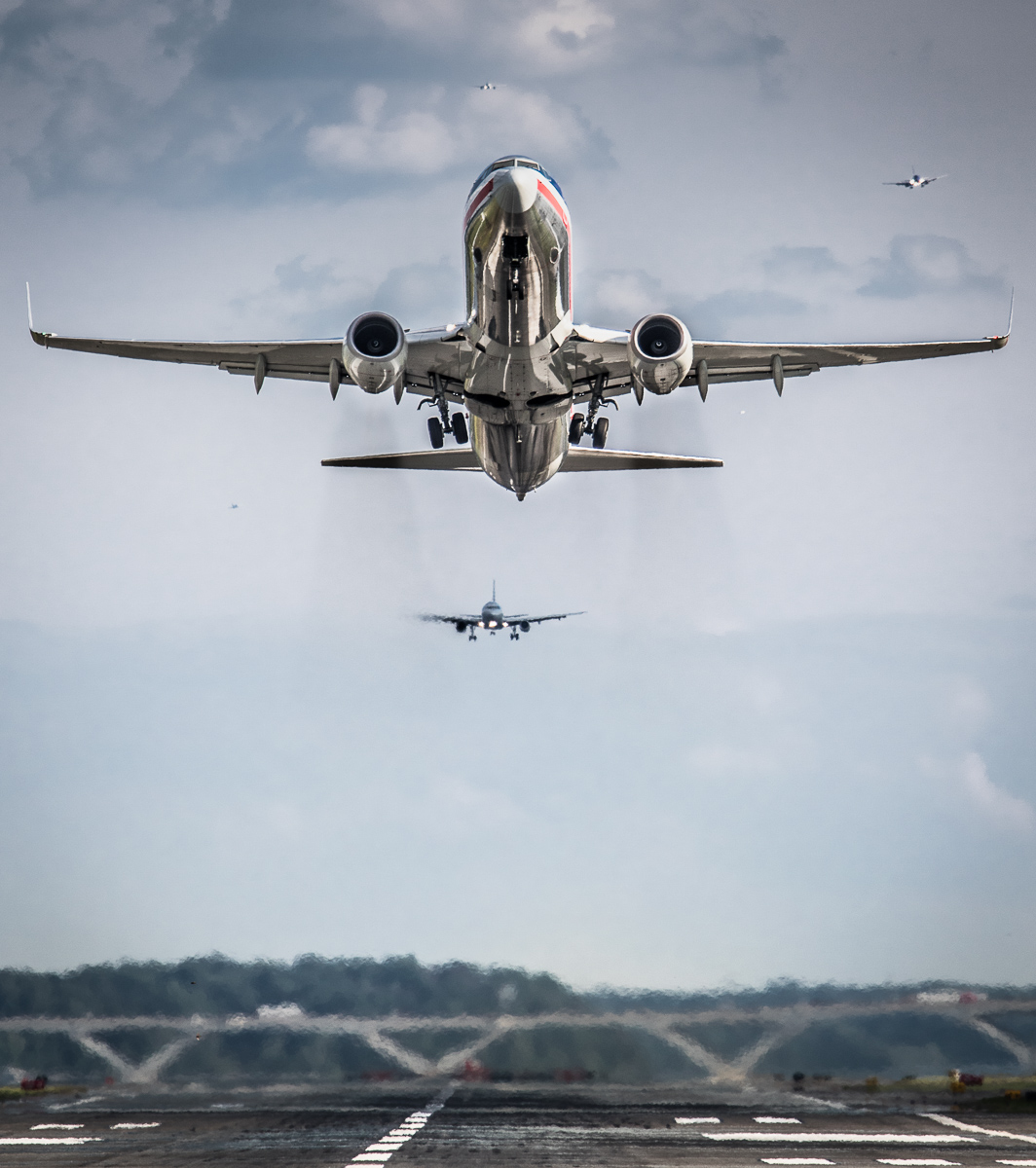 An American Airlines Boeing 737 taking off from National Airport near Washington DC, while five other airliners are preparing to land in the distance. (Finalist 2016 Smithsonian Air & Space Magazine photo competition, and Editors Pick for Aviation Week & Space Technology photo competitions)