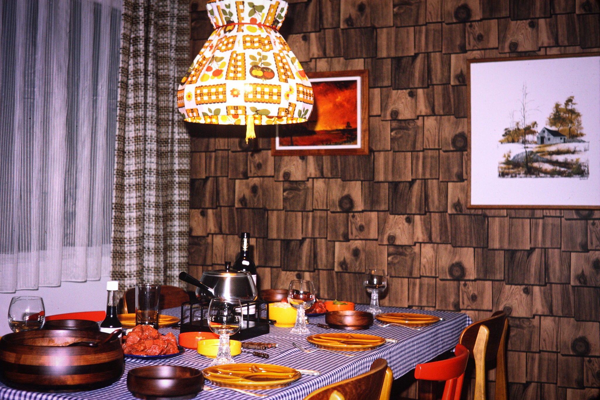 "I grew up in apartments which we rented until my parents purchased this condo in Mississauga. We would spend holidays in rented cabins in cottage country and my mother loved the cozy cabin feel so she created it in our dining space. The ""wood"" wall is actually wallpaper which never intimidated my parents. I think we had wallpaper everywhere we lived! You can see my parents European influence here for sure! They were both German immigrants."