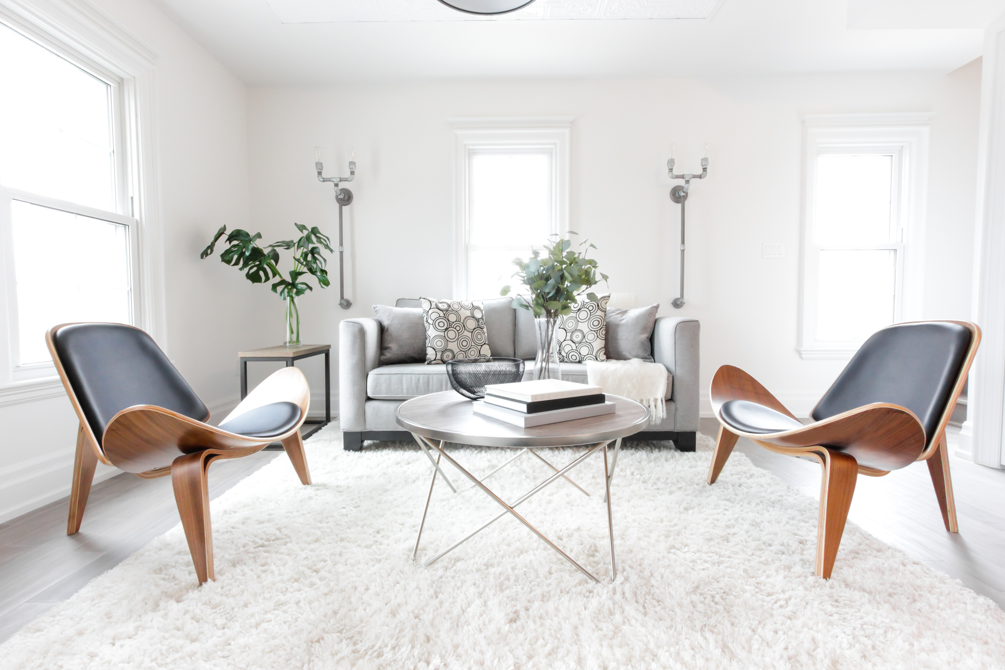 Living Room Home Staging in Barrie. Cool modern chairs add style and sophistication to this home for sale