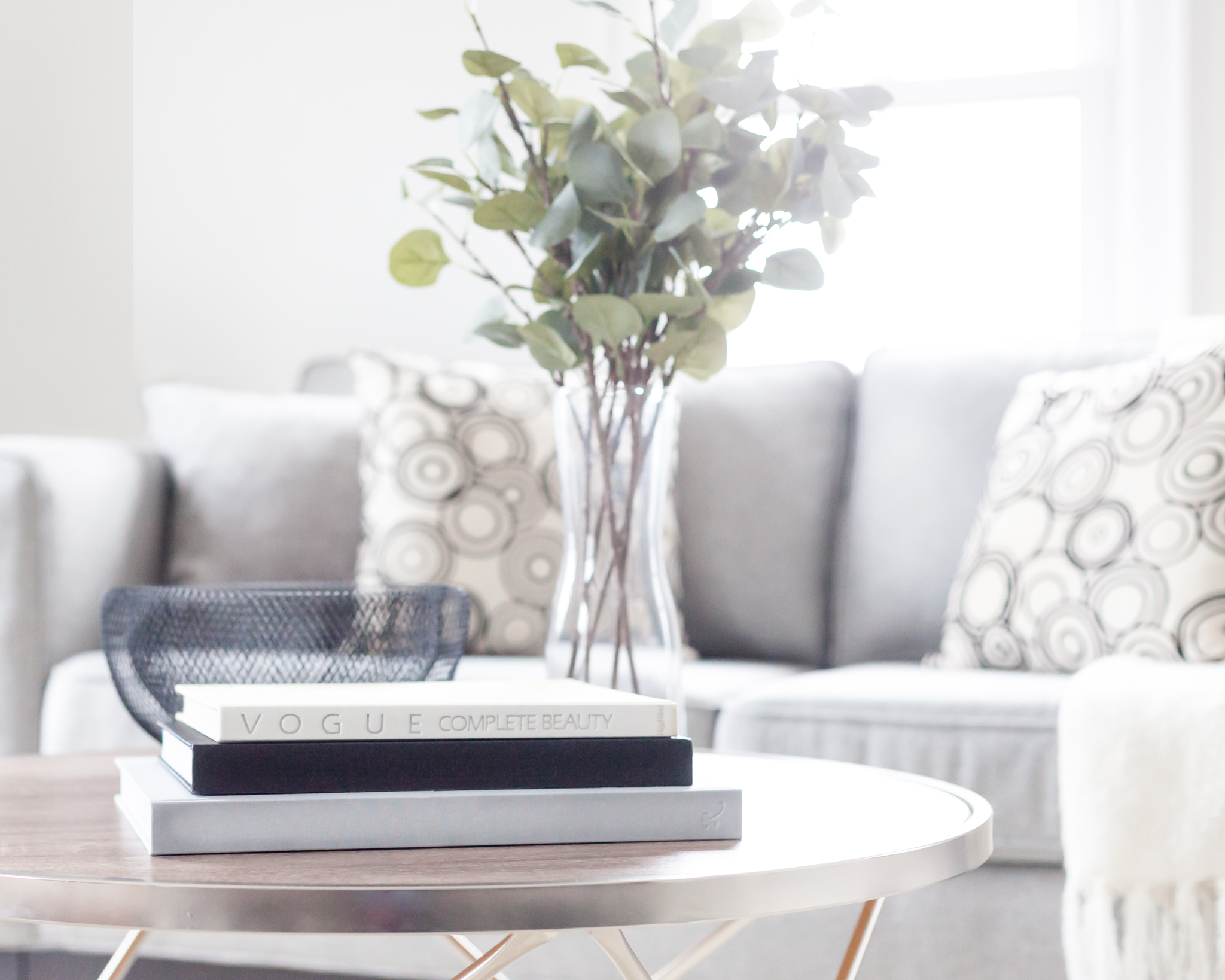 Home Interior Staging in Barrie provided by New Leaf Decor. Coffee table books are great staging props when selling your home.