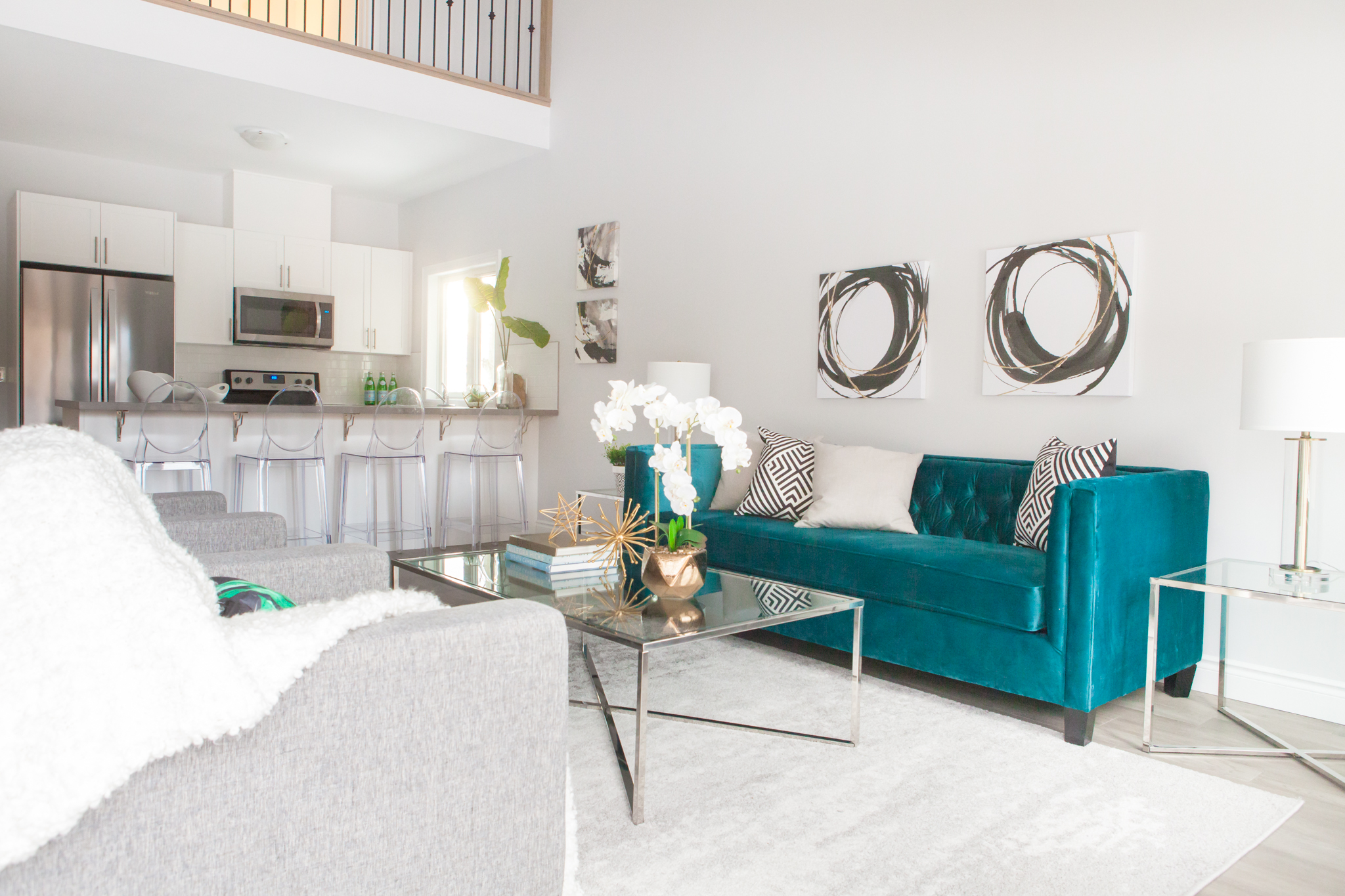 Home Staging project in Barrie. This emerald green sofa looks amazing in the space.