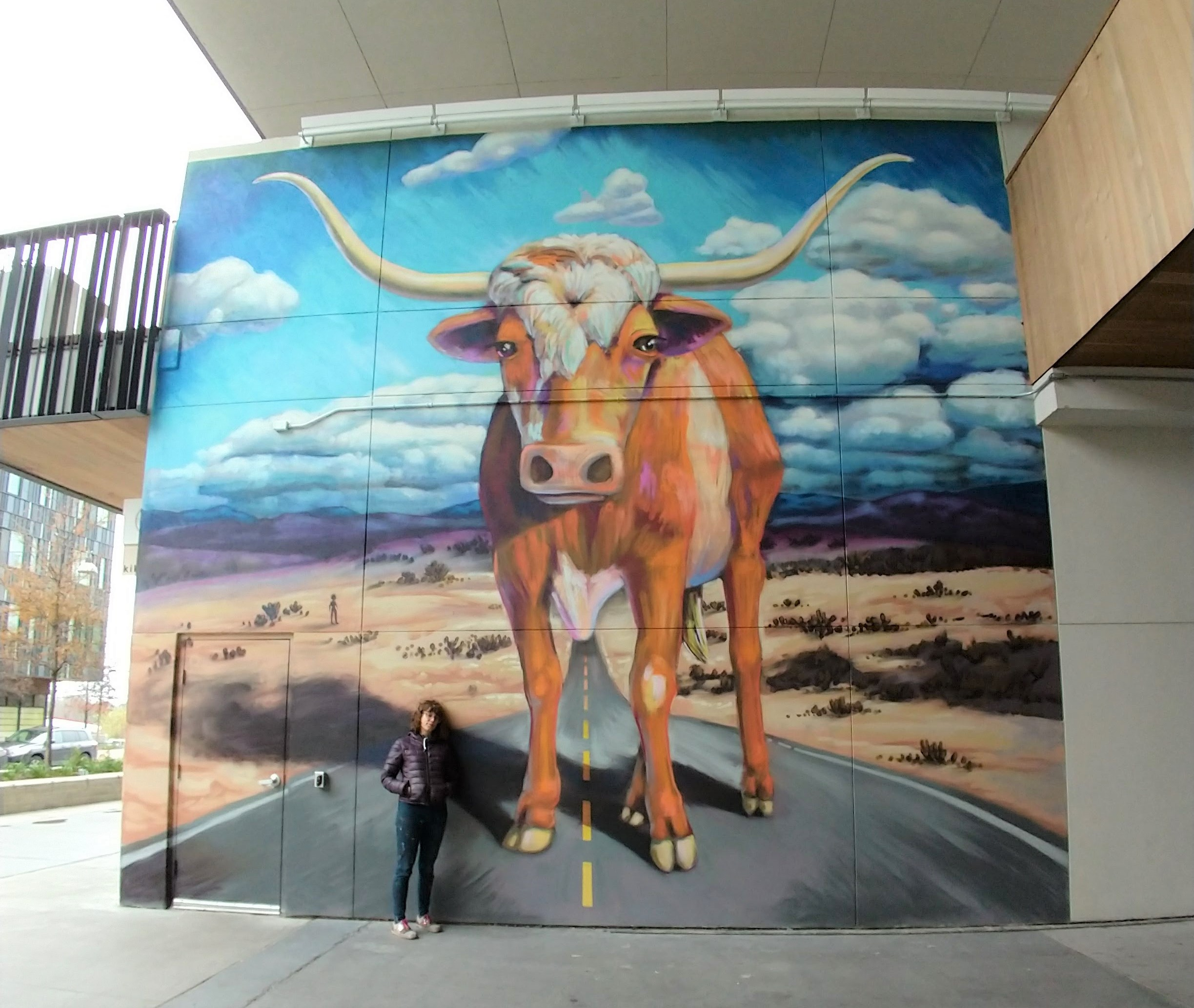 Long horn Mural Wide Angle with Artist.jpg