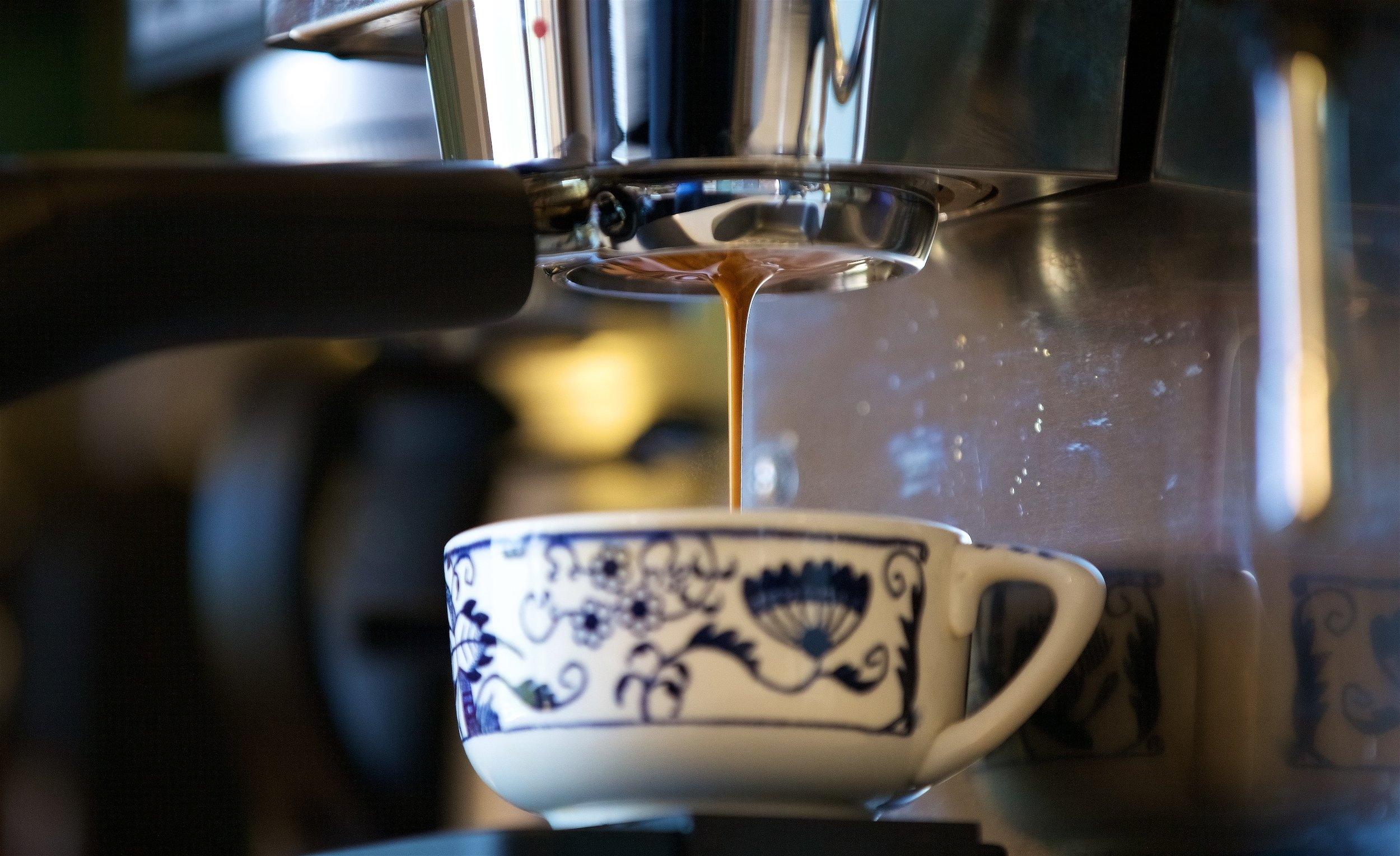 Near the end of a pour the espresso consolidates into a single thick stream of a brown color.