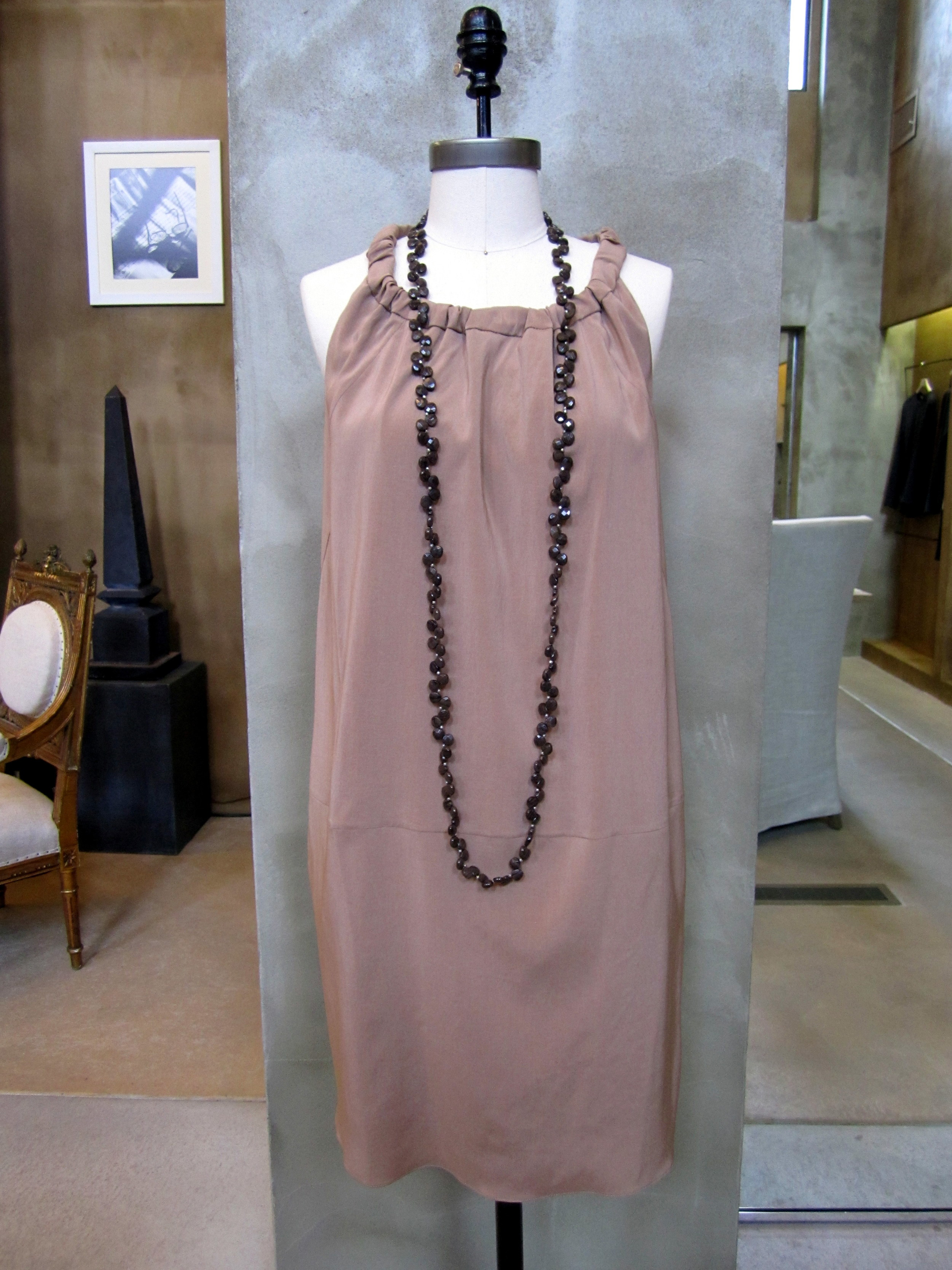 Brunello Cucinelli Silk Stretch Tank Dress with Ruched Neck. Biscotti. $1240. Available in Large. Matte Bronzite Necklace. $1150. Made in Italy.