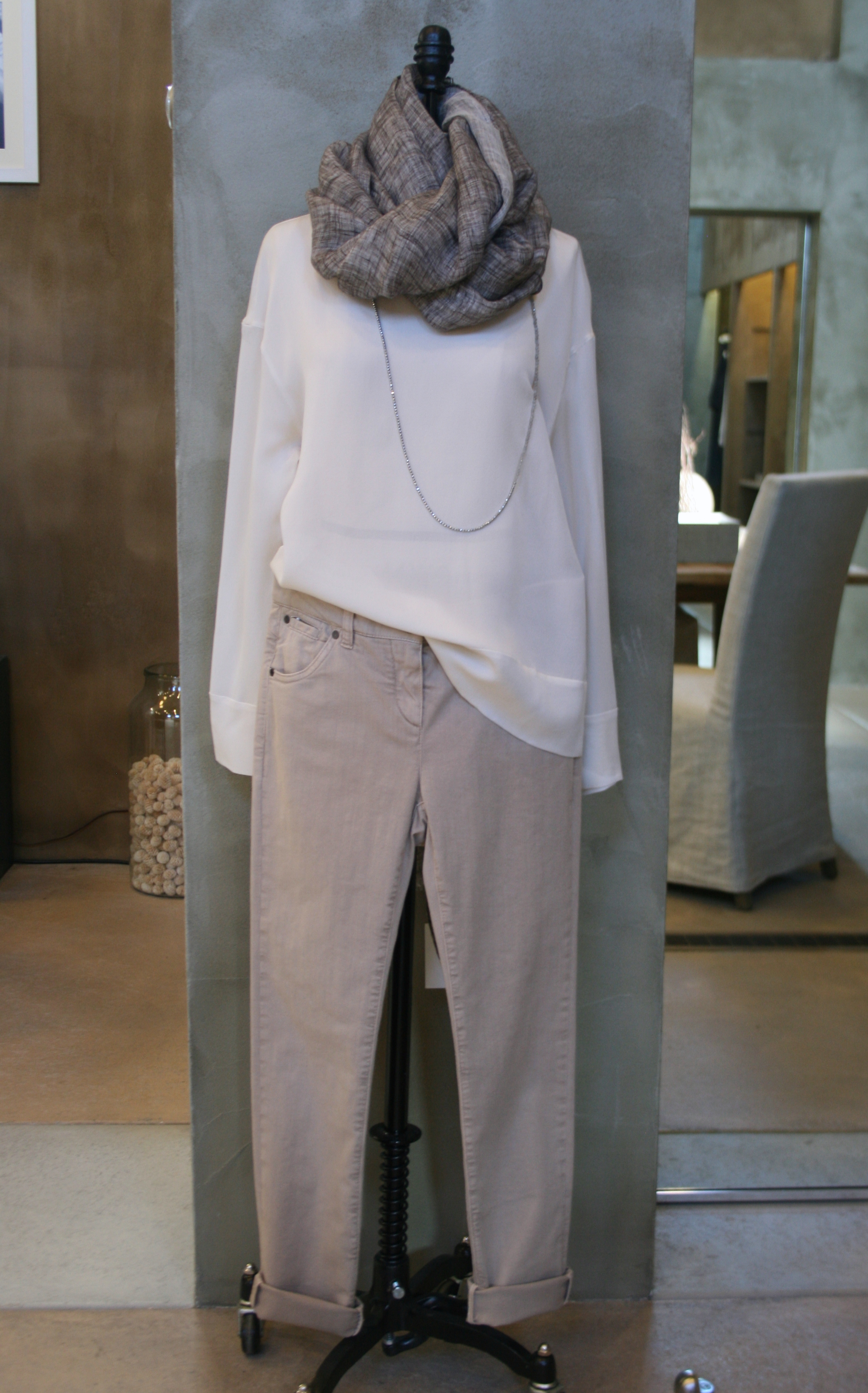 Brunello Cucinelli Long Sleeve Silk Crepe Top. Vanilla. $960. Available in Medium and Large. Garment Dyed Basic 5-Pocket Pant. Desert. $725. Available in 6, 8, and 10. Double Linen Scarf. Oat. $780. Made in Italy.