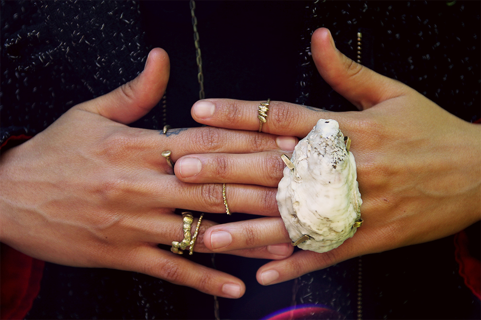 interlocked hands brass rings and oyster shell.jpg