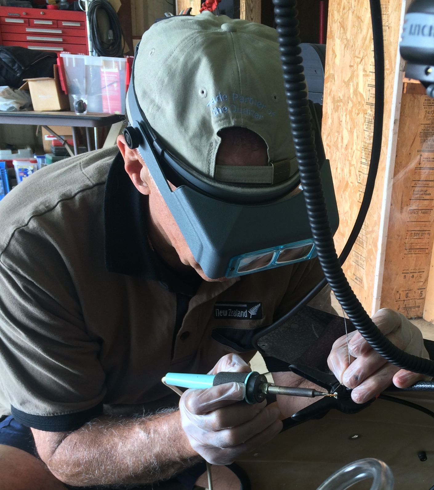 Manouch solders a wire during the radio installation.