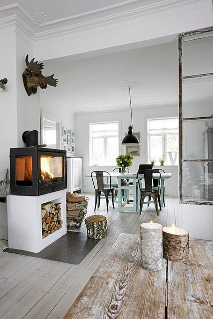 the natural wood, the raised fireplace