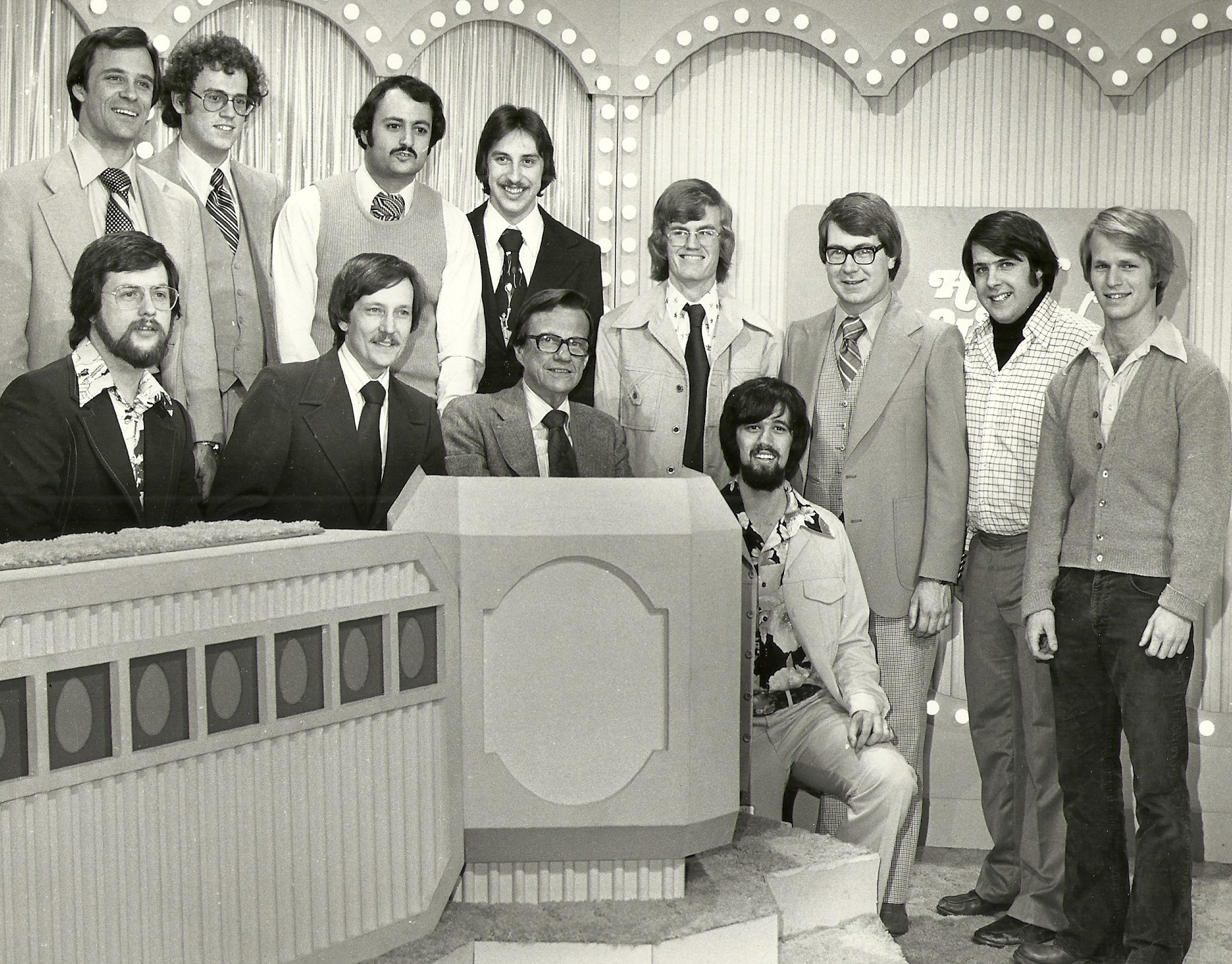 """TV game show host Bill Cullen and the QUBE technical crew for the first interactive game show """"How Do You Like Your Eggs?""""—which was broadcast to 200 homes in Upper Arlington during the summer of 1977. Jim is seated on the far left."""