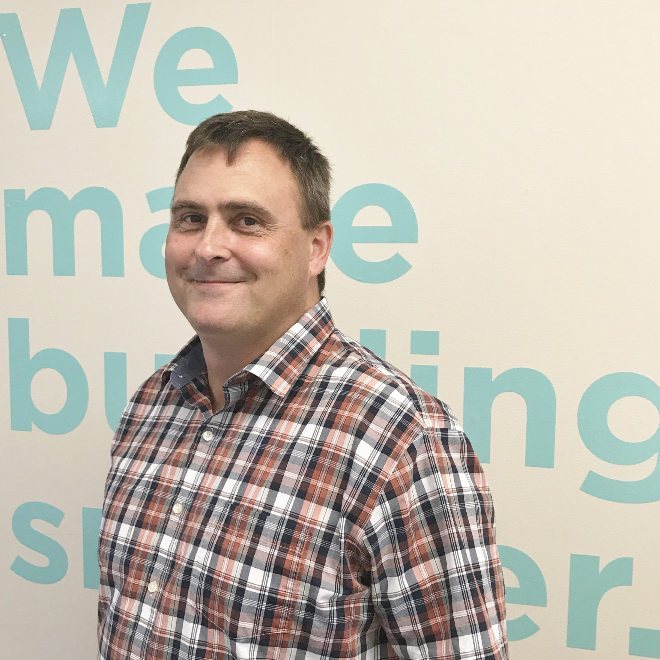 Celebrating his one-year anniversary at Integrated Building Systems and helping to make buildings smarter with technology: Jason Lawrence