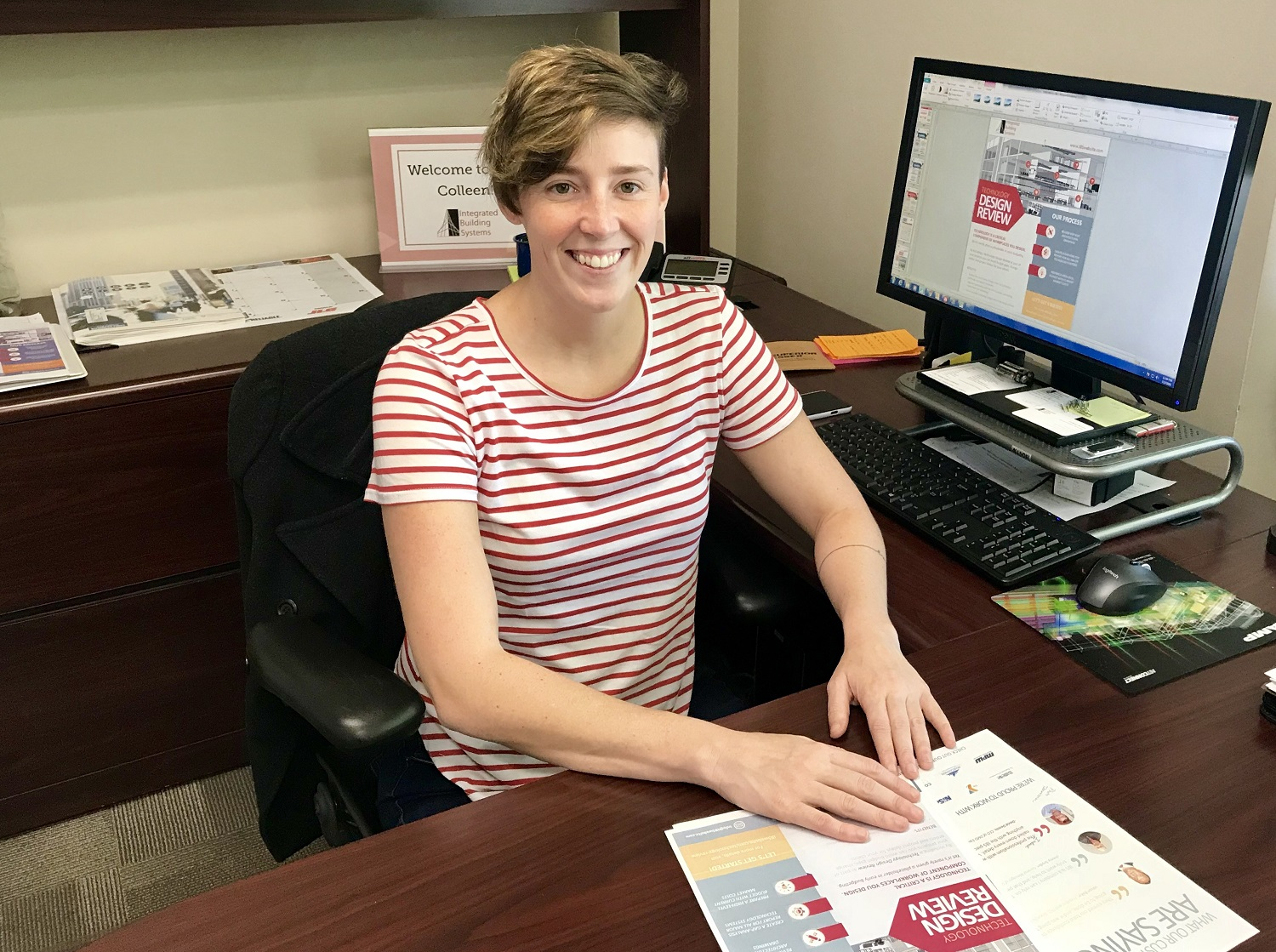 Colleen McLain, wrapping up new marketing documents for Integrated Building Systems'  Technology Design Review  process and customer testimonials