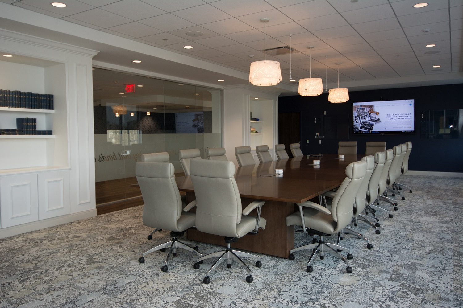 The board room features state-of-the-art technology for audio and video conferencing, including collaboration tools  , discreet ceiling microphones, and touch-screen controllers.