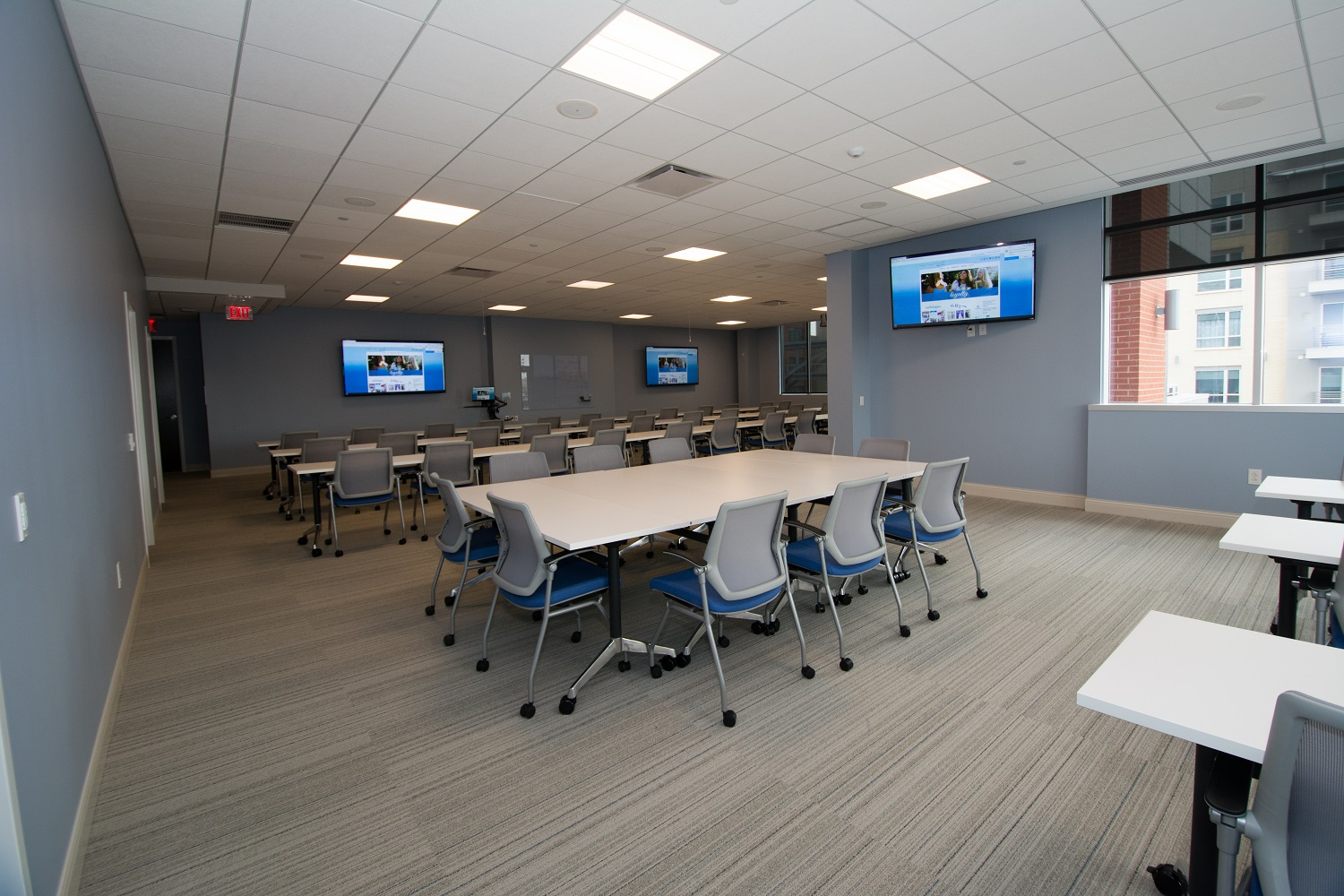 With seating for 50+, this training room offers complex audio, visual, and recording functions. New technology systems include an interactive, wireless presentation system; a video streaming and recording system; three large TV screens; hard-button controls, touch-screen controls, and one master control processor.
