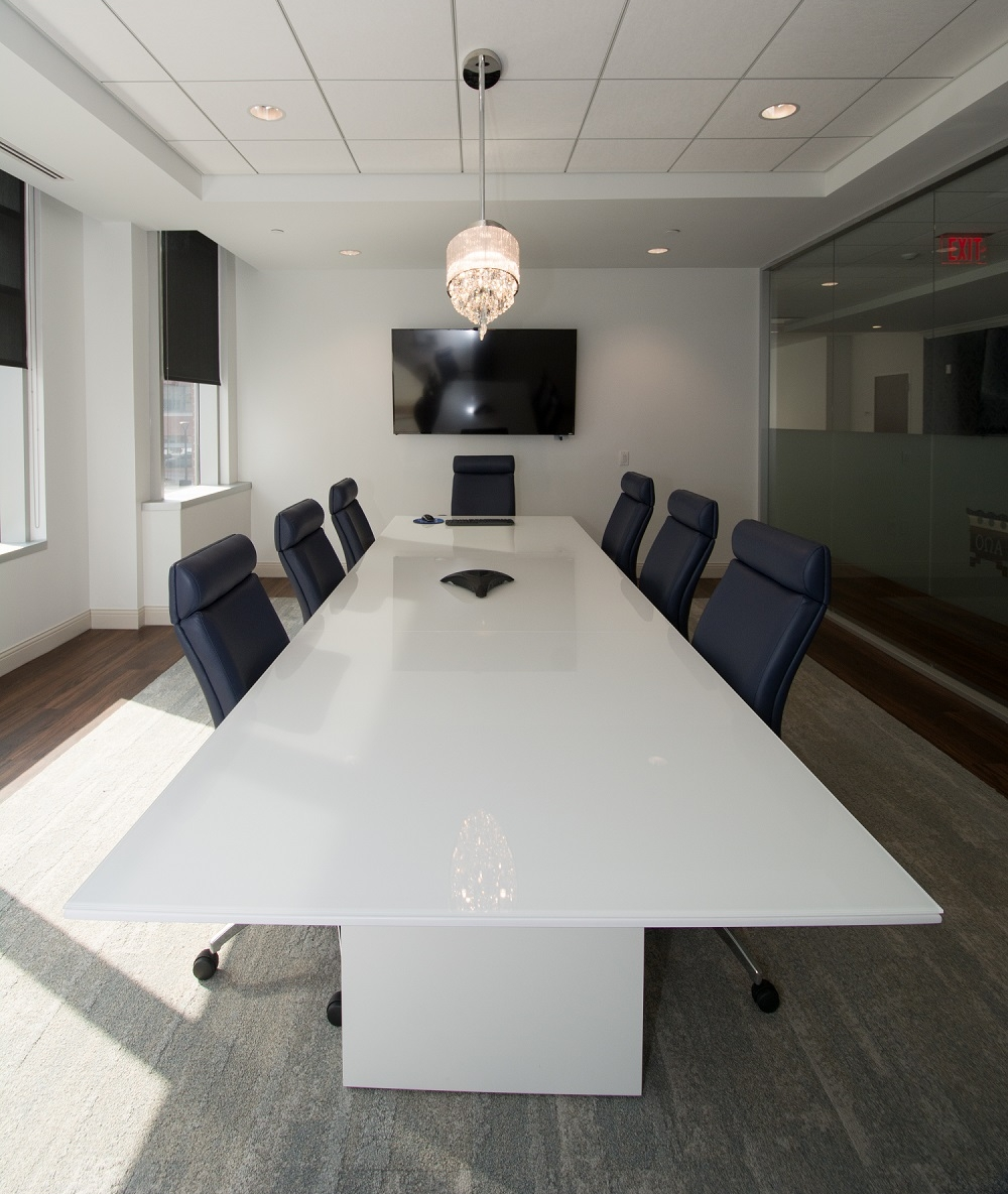 """This conference room features a wireless presentation system, 70"""" TV screen, and a hard-button A/V controller."""