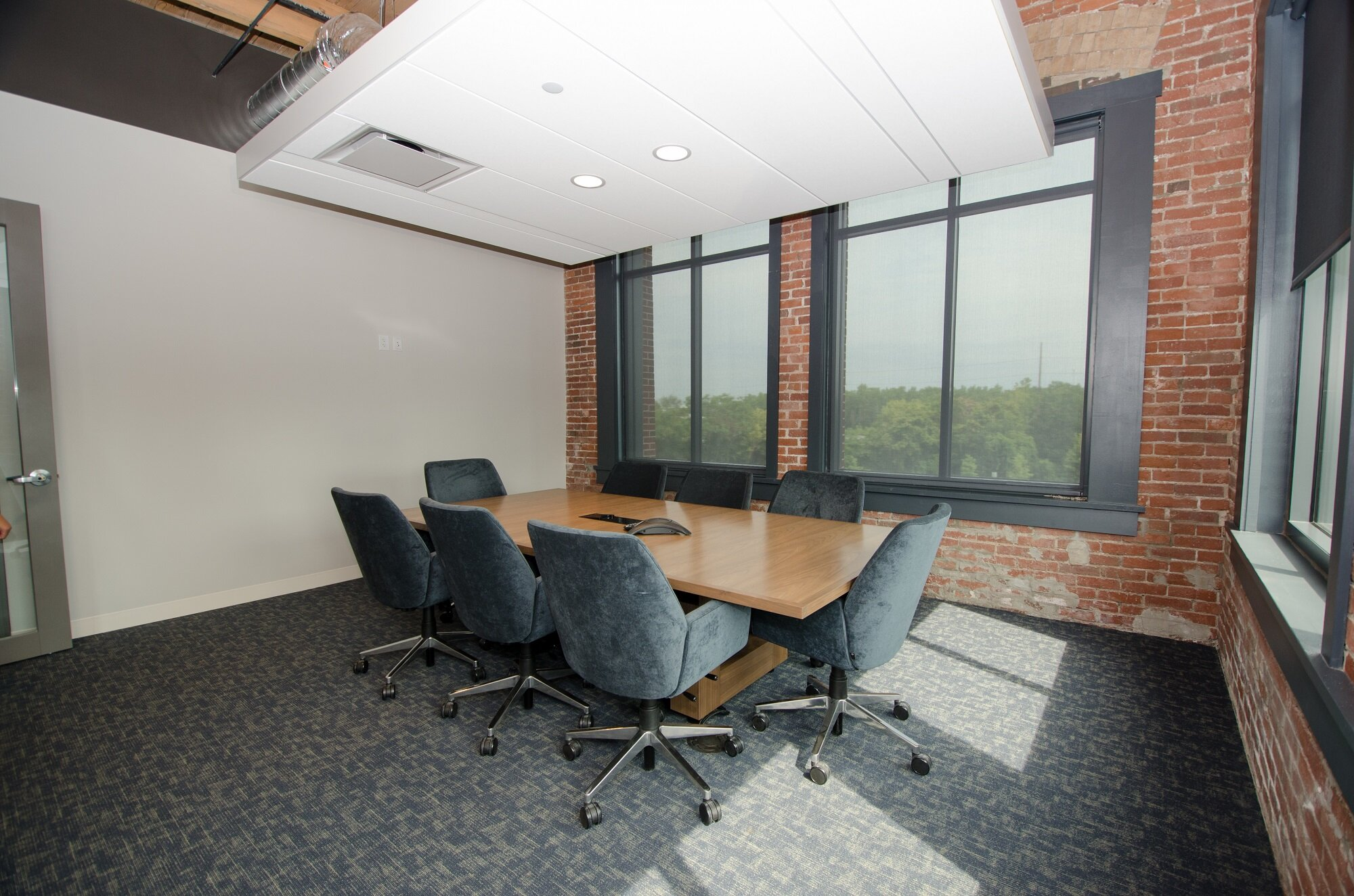Not every meeting room at    Plaskolite's new headquarters    featured A/V equipment on day one, but thanks to cost-effective design-stage planning, every space has the power and network connections (see the outlets on the white wall) to add them easily.