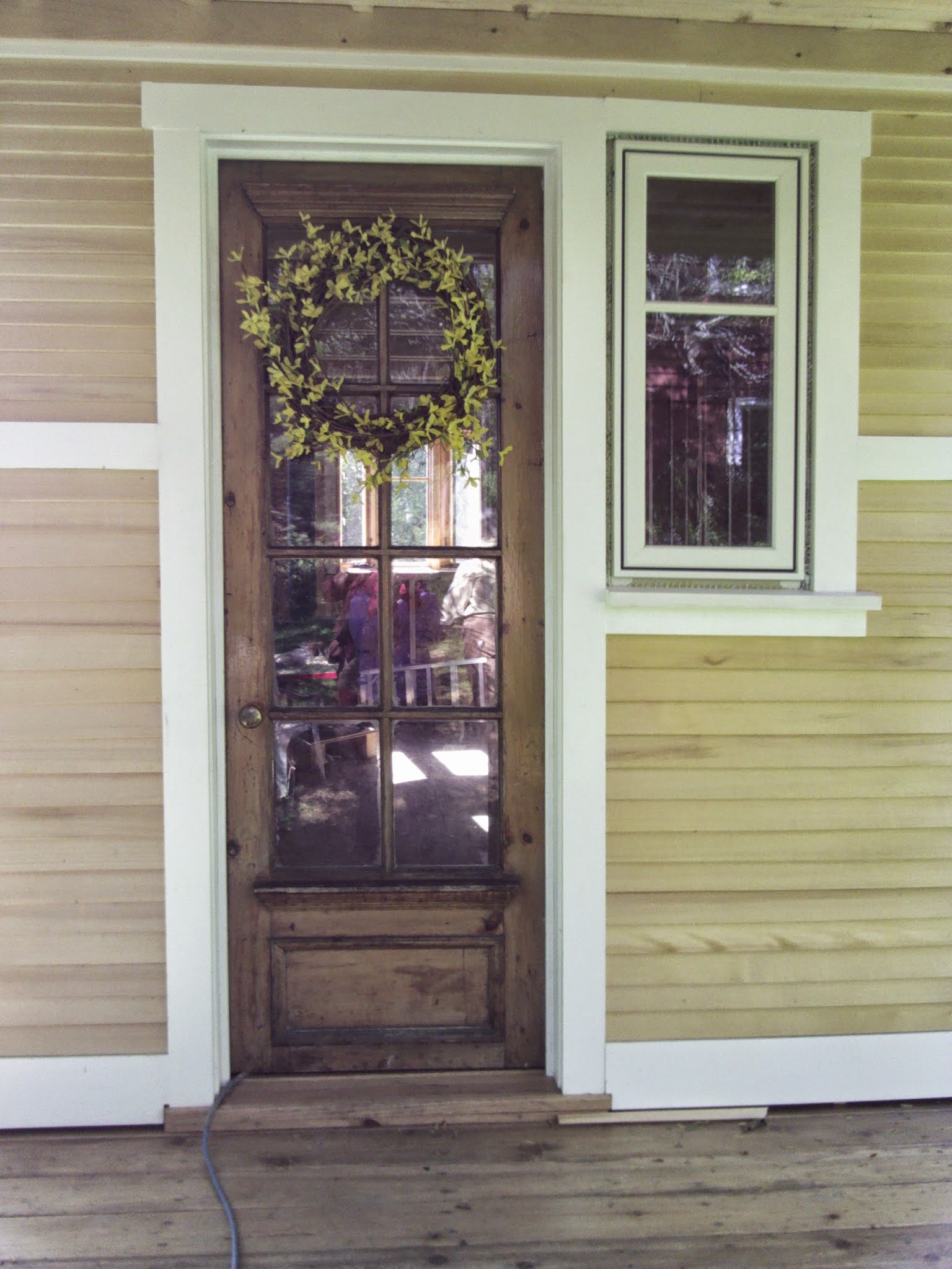 This antique door was found salvaged and cut down to size. Many people need to cut down the door for their home, so buying a used, salvaged, cheap door is a good idea since you're going to be modifying it anyway.