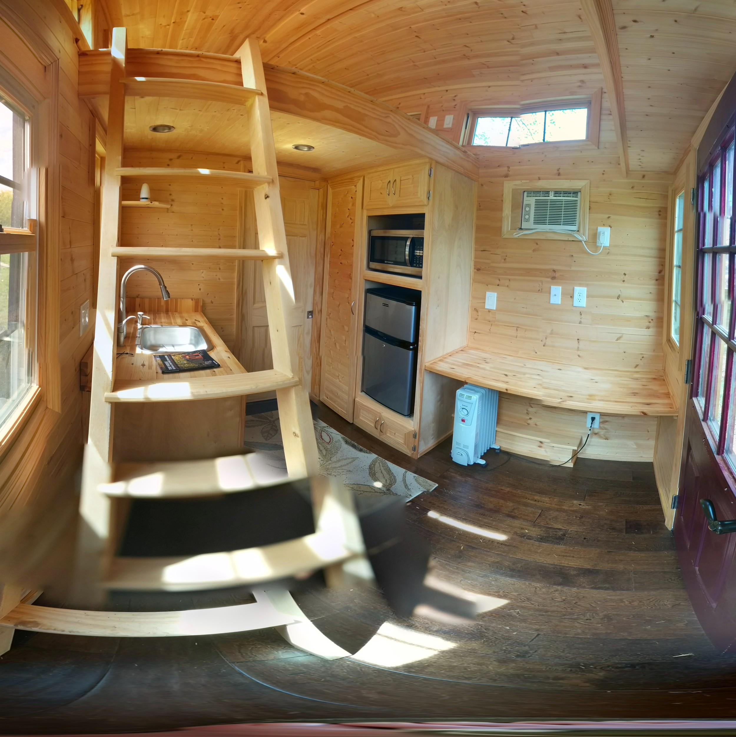 "I tried to take a ""photo sphere"" picture of the inside of the tiny home on location so you can see the inside better, obviously the stitching isn't great but you get the idea!"
