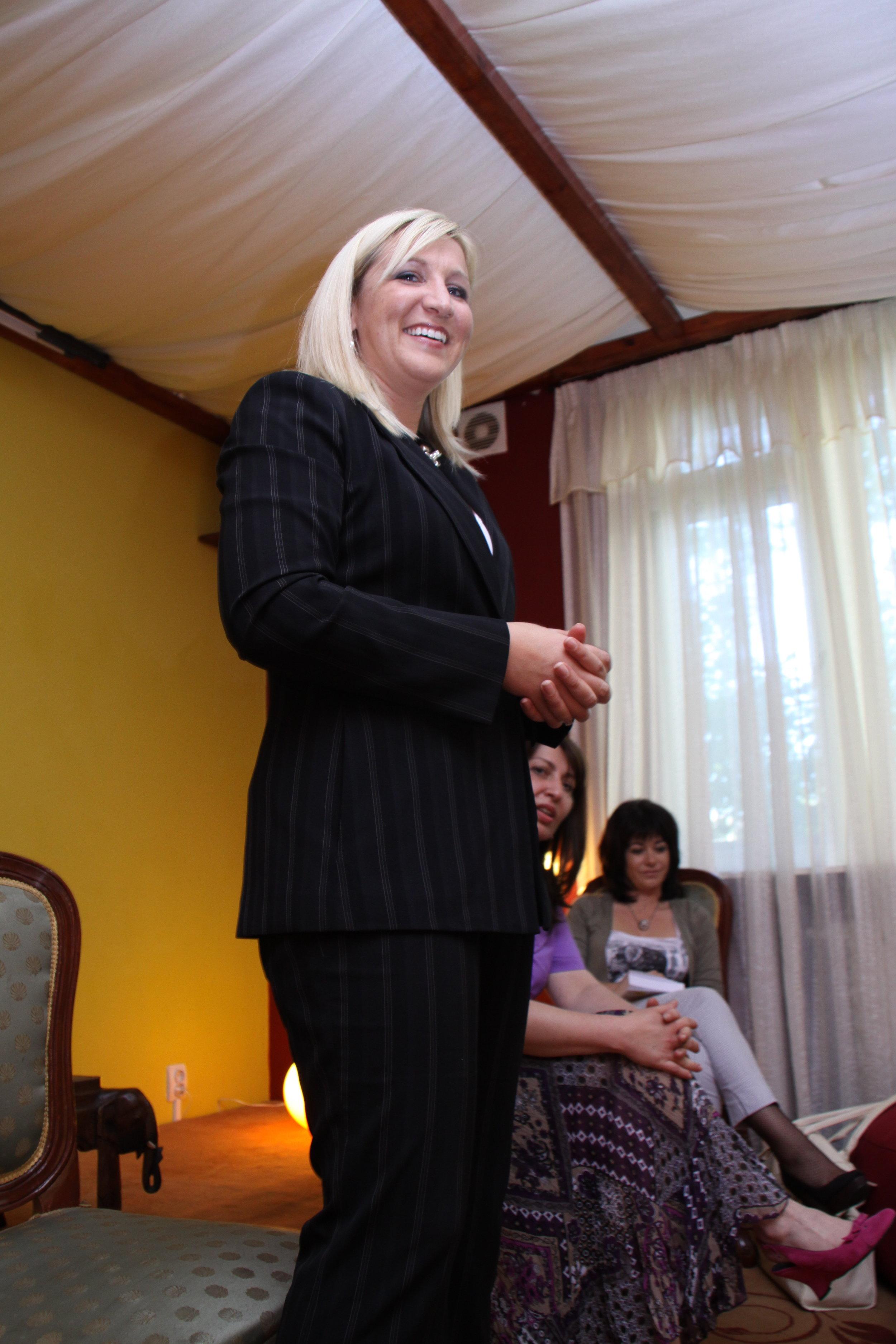 Tara giving a talk during a book launch in Romania