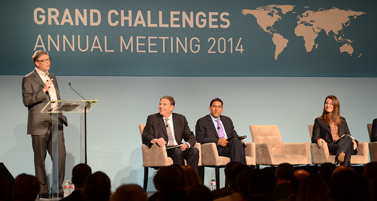 Bill Gates speaking at the 2014 Grand Challenges conference in Seattle, joined by Alain Beaudet, Canadian Institutes of Health Research, Raj Shah, USAID chief and Melinda Gates. Photo courtesy  Humanosphere .