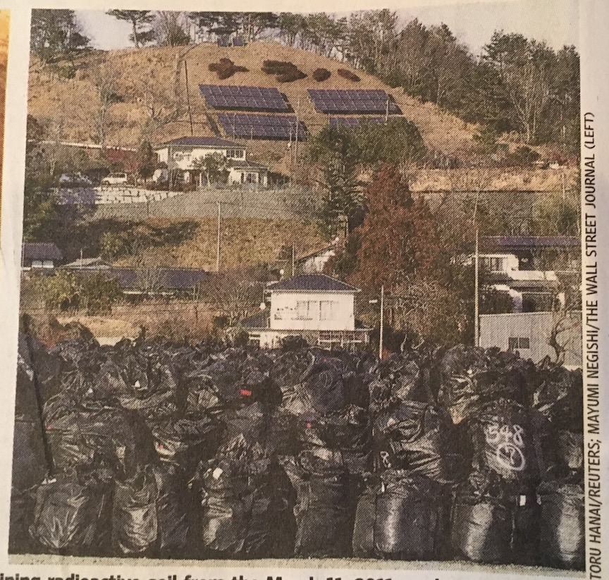 Solar array behind bags of radioactive waste.jpeg
