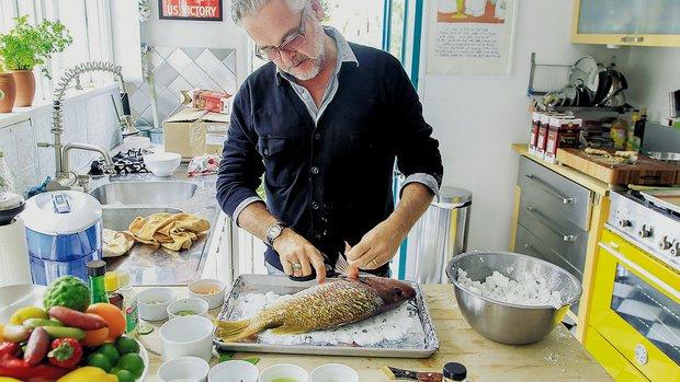 Chef Andrew Spurgin preparing snapper (photo by Eduardo Conteras)
