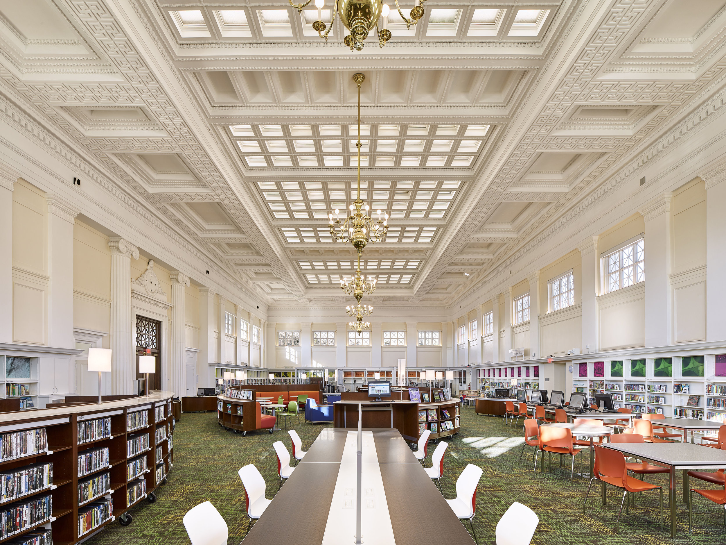 "By introducing a simple 2 by 2 18-watt LED lay-in troffer, we were able to completely transform the existing ""skylight"" into a functional element while maintaining the library's very strict budget."