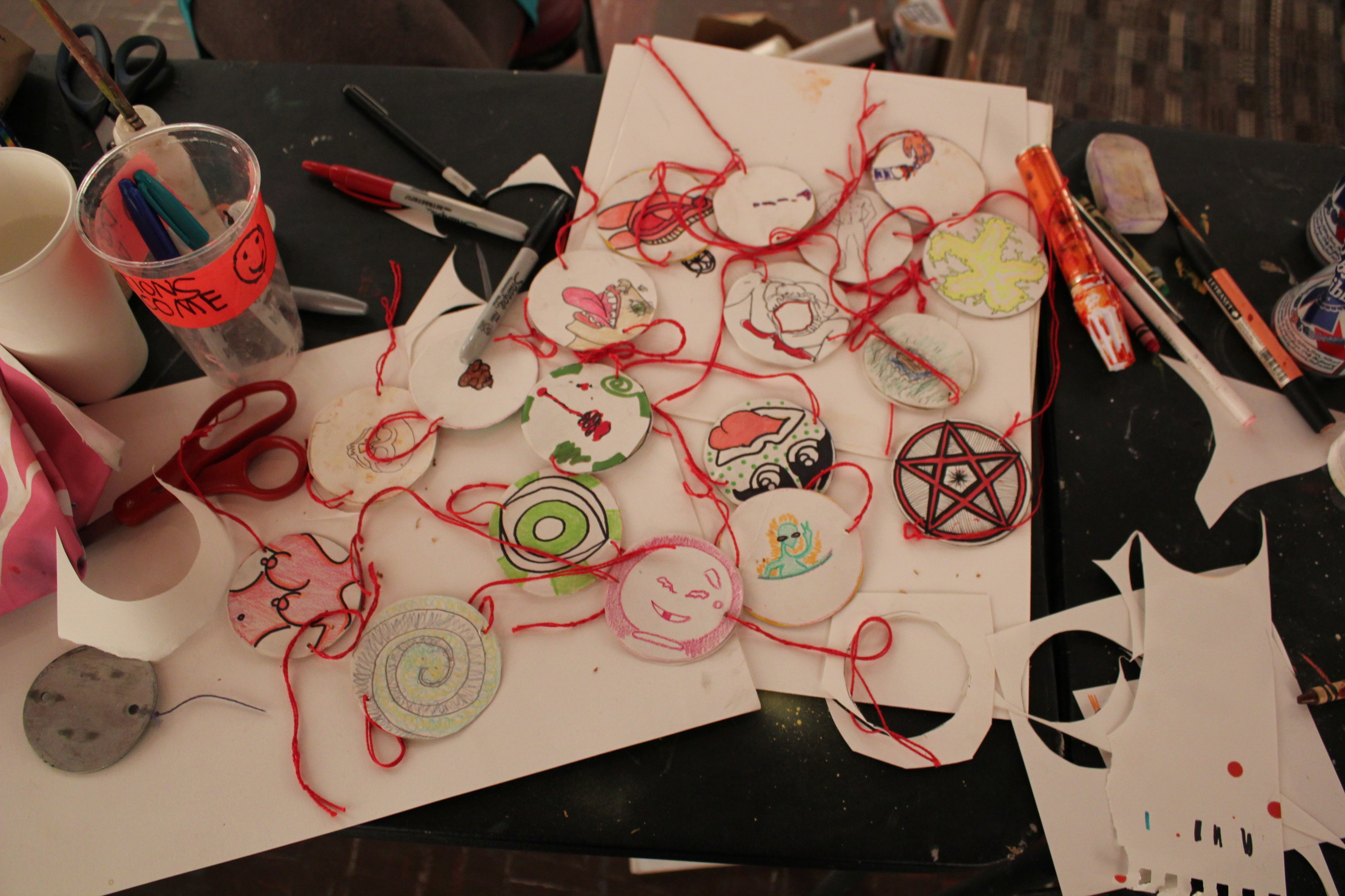 Aftermath of the thaumatrope workshop at the Peanut Gallery in October 2013.