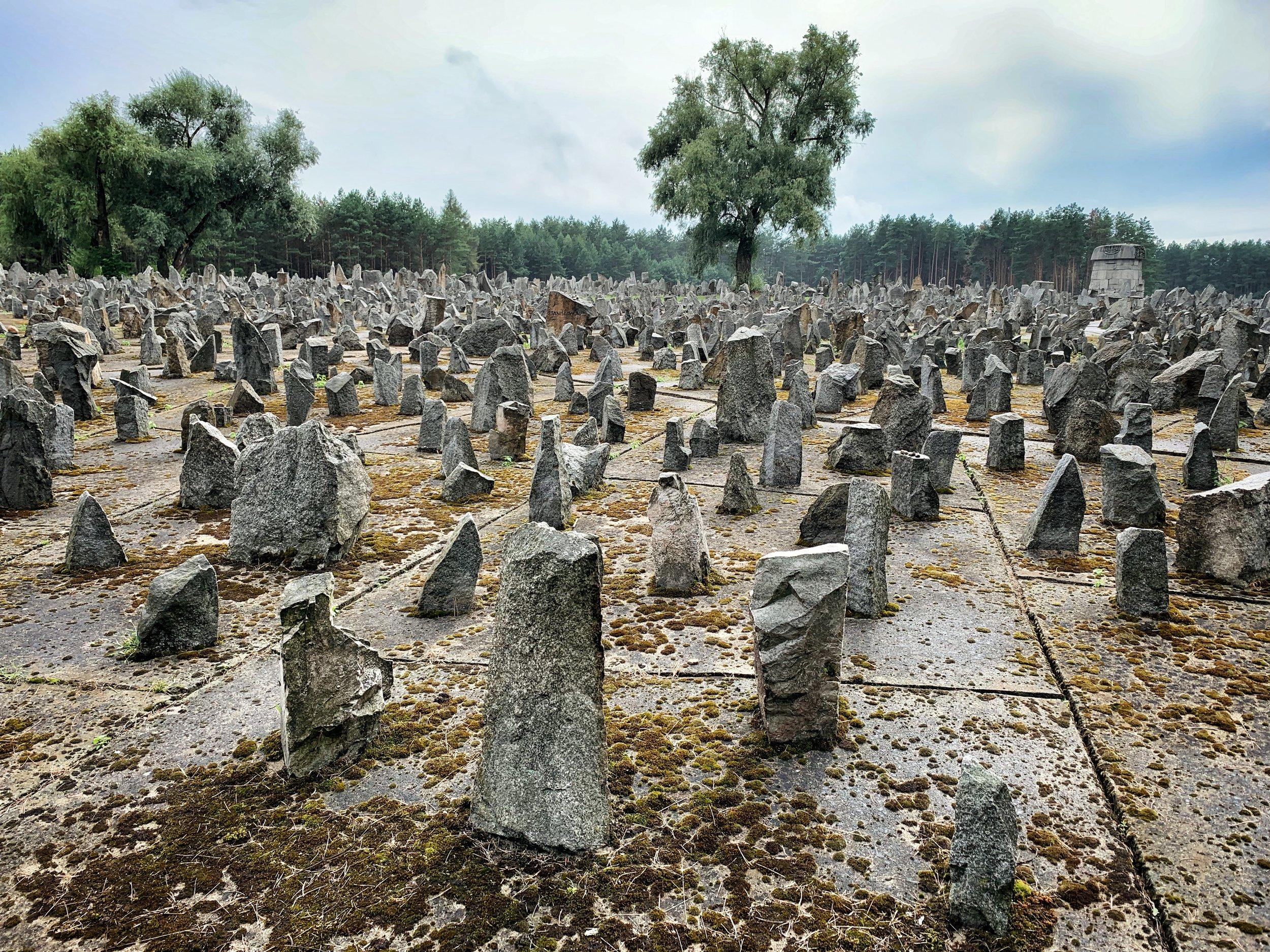 Jagged stone memorial markers represent burial pits — Treblinka