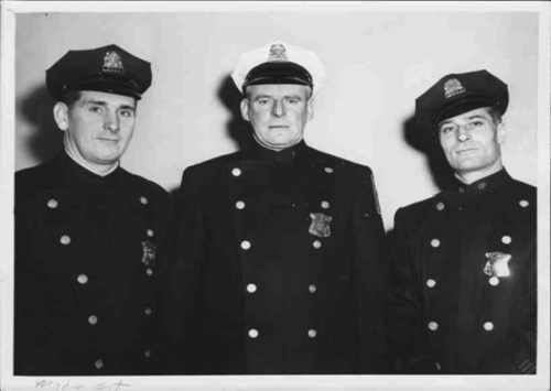 The author, left, poses with fellow officers.