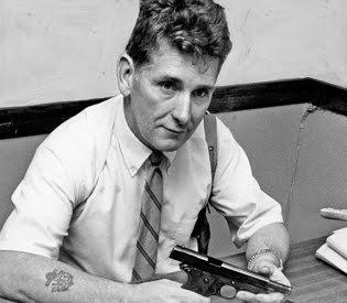Posing with a seized handgun