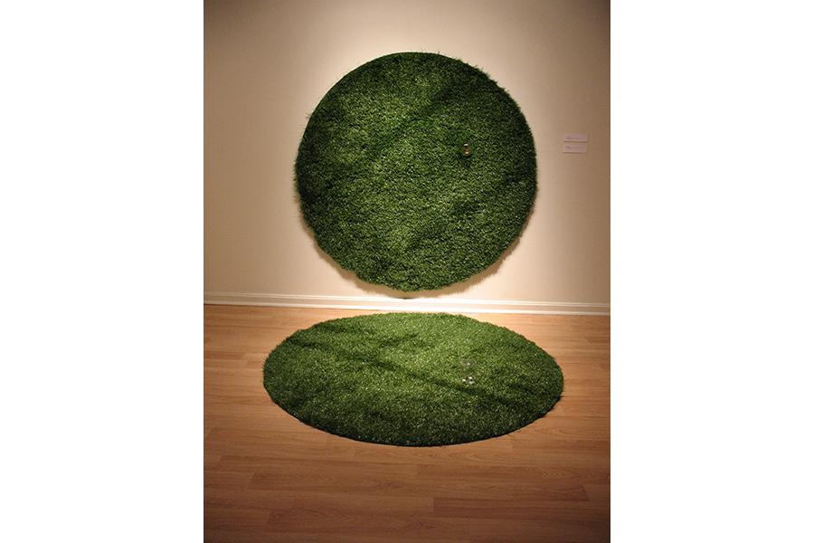 "Gotcha 2 artificial grass, glass jars, and monopoly houses,each circle 72"" diameter"