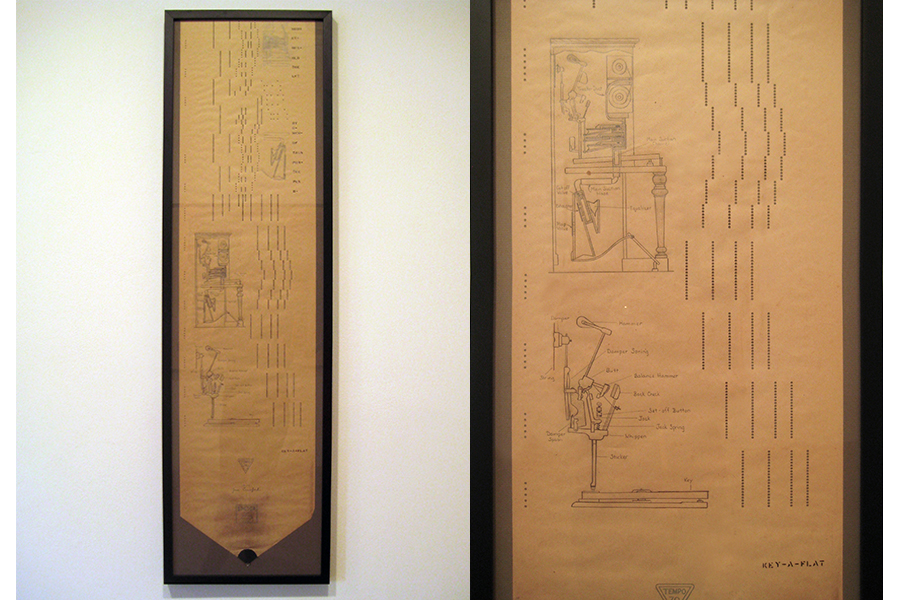 "Wow and Flutter: Player Piano Diagram  Framed piano roll and graphite, 49""x14"""