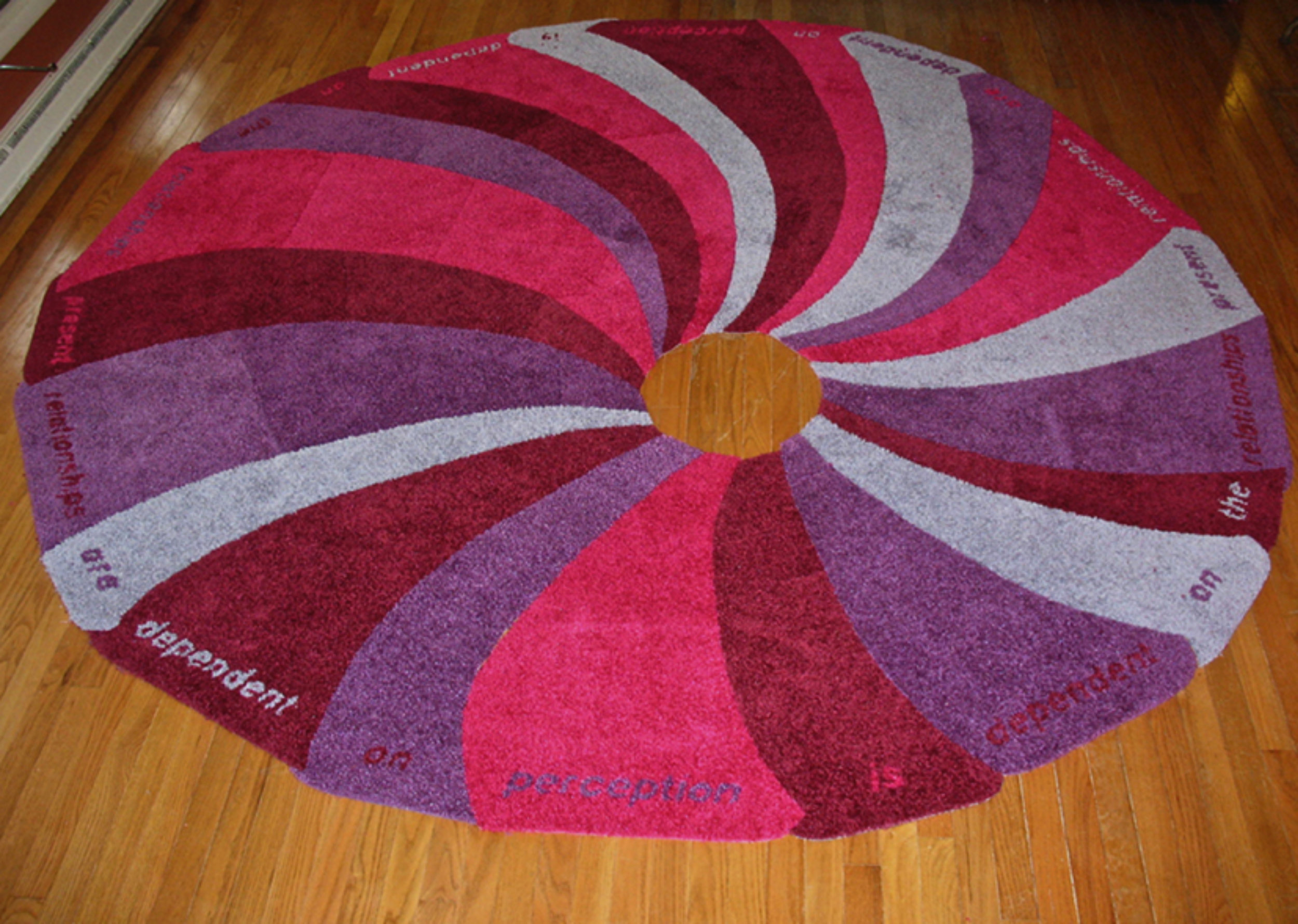 Image 19  Title: Forces of Nature: Whirlpools and Walmart Bath Rugs  Year: 2008  Dimensions: 108 in x 116 in  Media: Walmart clearance bath rugs and duct tape