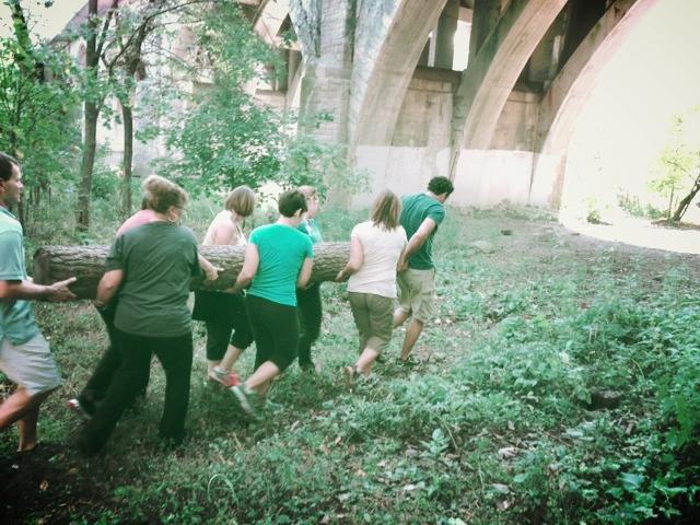 group carrying log.jpg