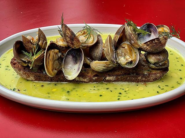 Smoked Manila clams on Toasted sourdough bread with dill and parsley butter. #wallflowernyc #westvillage #manilaclams #delicious #nycrestaurants