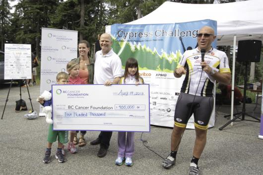 Geoff Glotman presenting a cheque for $400,000 to the BC Cancer Foundation on behalf of the Glotman Simpson Cycling Club.   (Credit: Sorensen Parker Creative)