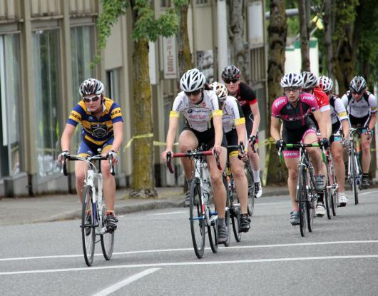 Liz leading the group up the hill in the crit