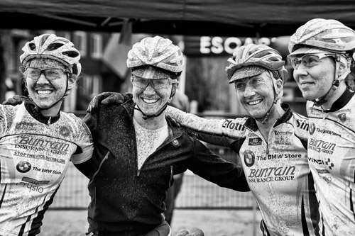 Smiles with the splatters of mud at a very fast, and dirty, EV Stage Race. Photo: Hung Mai Photography