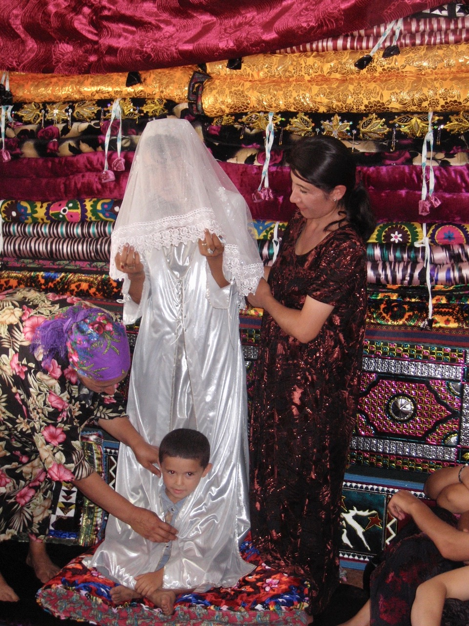 Boyson, Uzbekistan. Wedding, dowry quits and mattresses in background